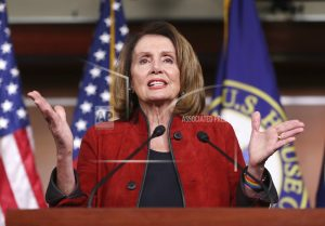 The Latest: Pelosi scorns 'five white guys' on immigration