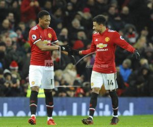Man United beats Stoke 3-0, reduces City's lead to 12 points