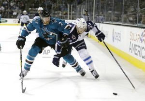 AP Source: Sharks place D Paul Martin on waivers