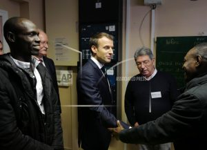 France's Macron visits Calais to preview new migrant policy