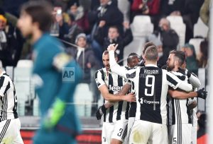 Juventus beats Genoa 1-0 to trail Napoli by 1 point