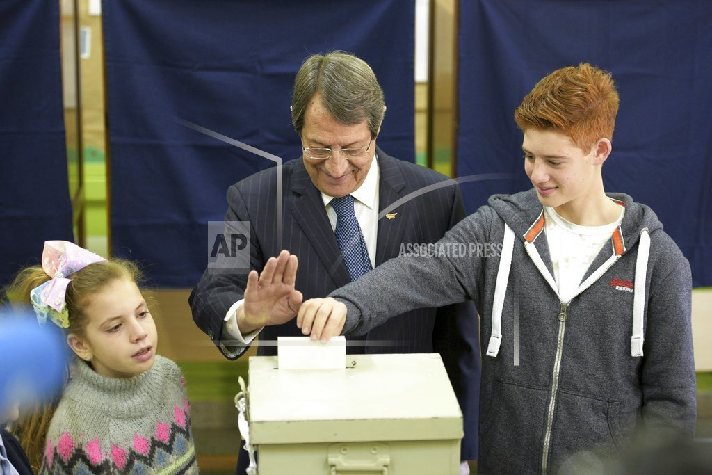The Latest: Exit poll has Cyprus presidential race in runoff
