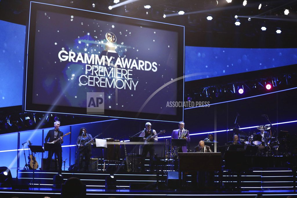 The Latest: Artists remember Tom Petty on Grammys red carpet