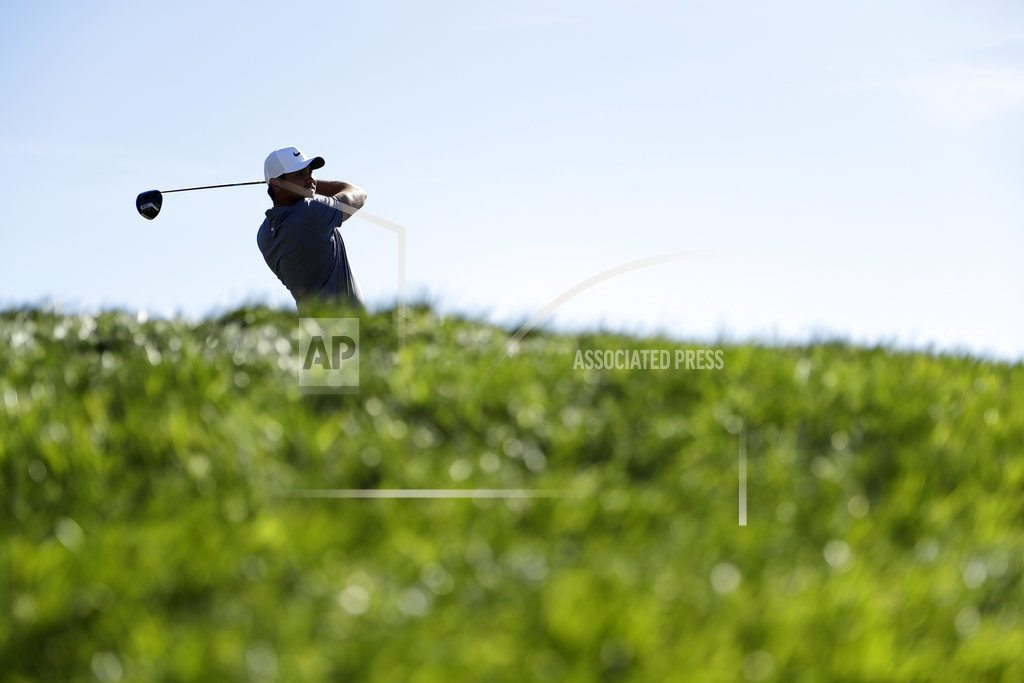 Day beats Noren on 6th playoff hole to win Farmers