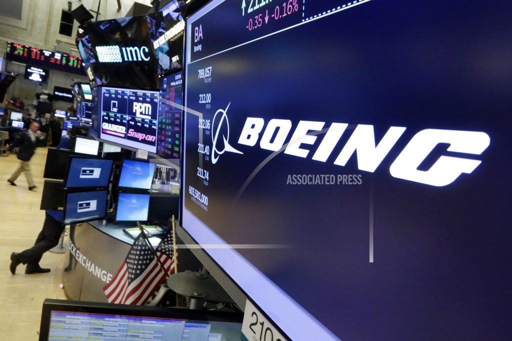Boeing profit tops expectations; gives strong 2018 outlook