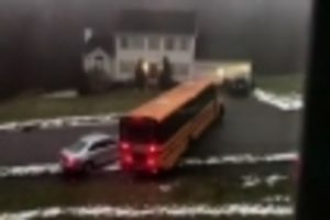 Full school bus slides down icy street, students unhurt