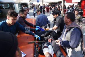 The Latest: Official: 63 dead, 151 wounded in Afghan attack