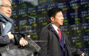 Asian shares mixed, reverse early gains echoing Wall Street