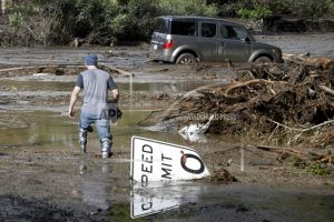 Victim search expands as California storm, mudslides kill 13