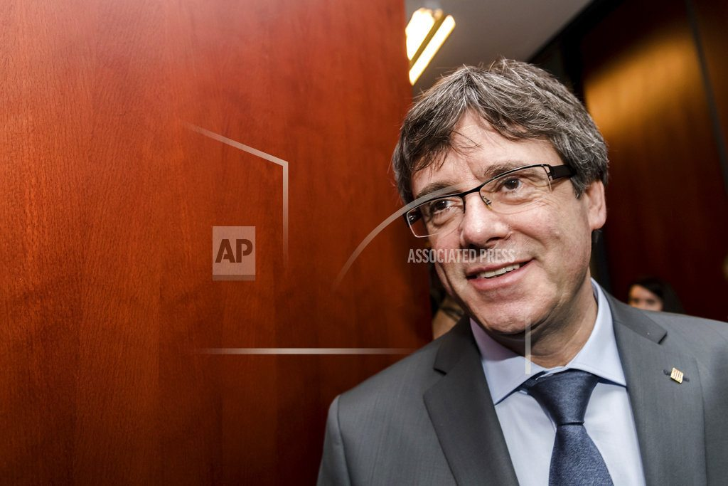Ex-Catalan leader to ask judge's OK to attend parliament