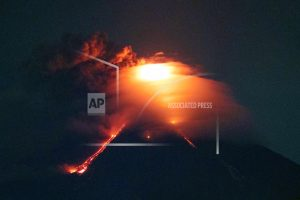 Glowing red lava rolls down slopes of Philippine volcano