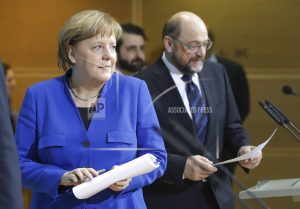 The Latest: Merkel confident on Europe with new German govt