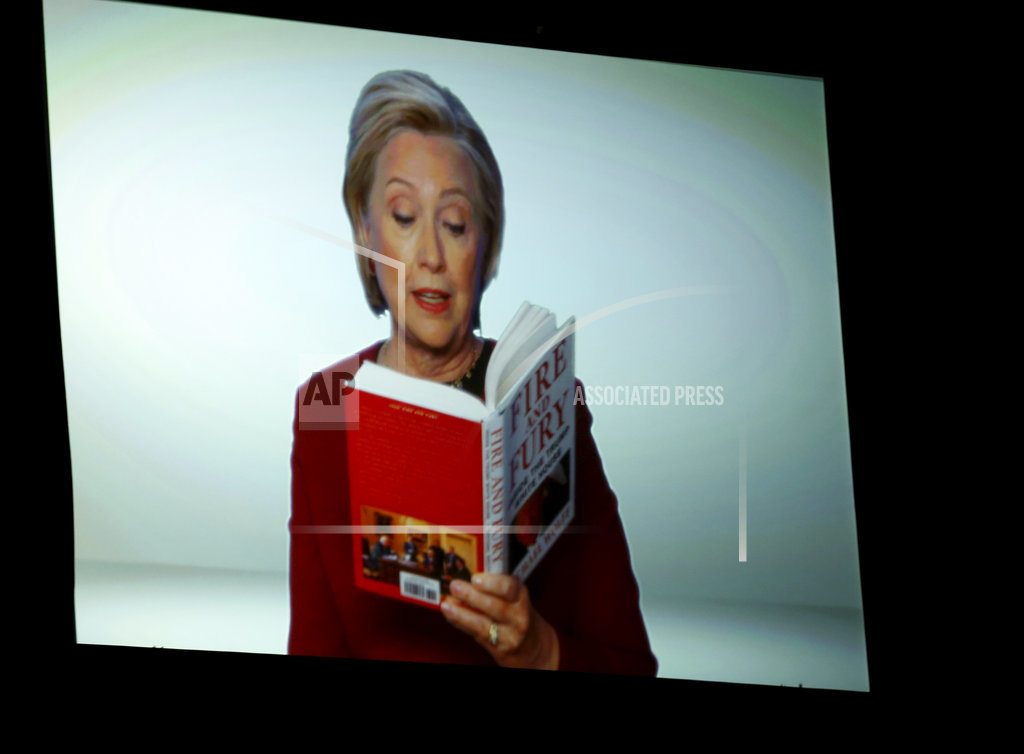 The Latest: Grammys feature Clinton cameo in Trump book bit