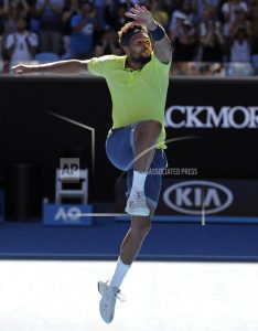 Tsonga leaps, stretches, lunges in Australian Open comeback