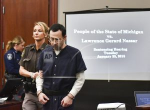 The Latest: MSU trustee sorry for comments on Nassar case