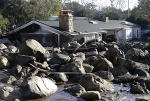 Rescuers 'searching for a miracle' in California mudslides
