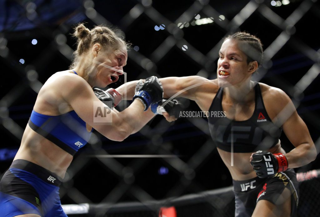 Rousey shifts to wrestling with surprise Royal Rumble cameo