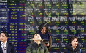Global shares mixed as China reports strong growth data