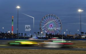 The Latest: Punctured tire drops Alonso's team off pace