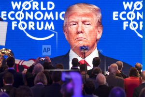 The Latest: Trump back at White House after Davos trip