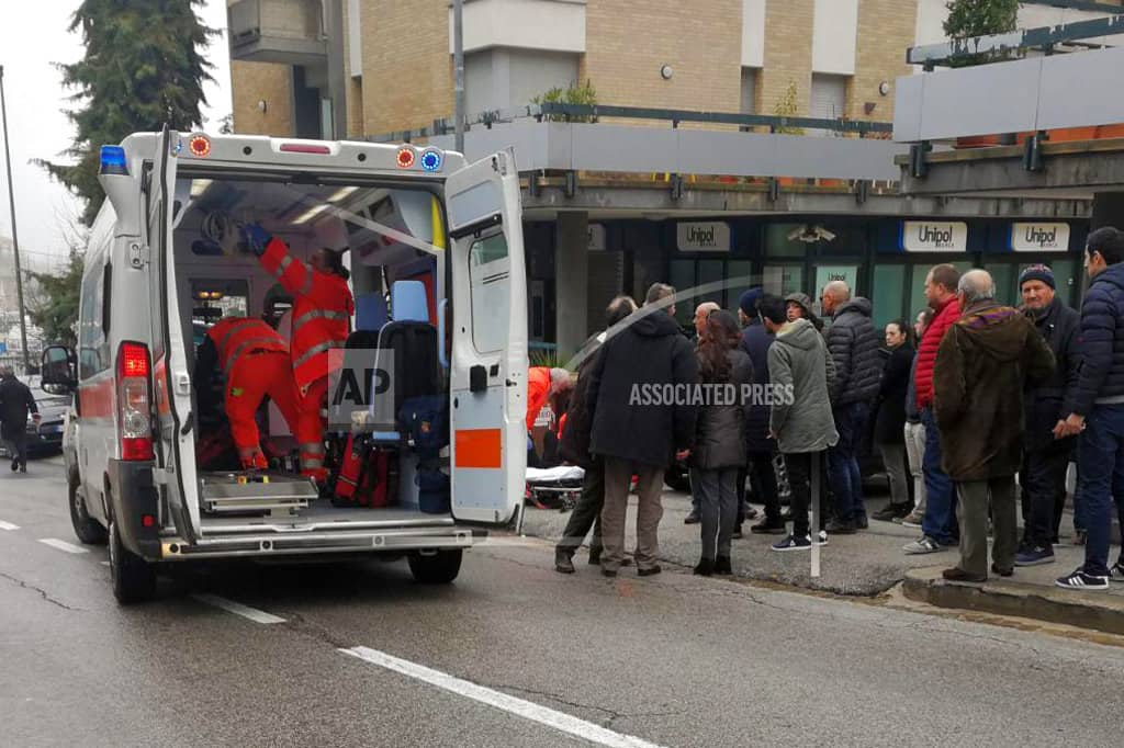 The Latest: Italian mayor: 6 wounded in shootings