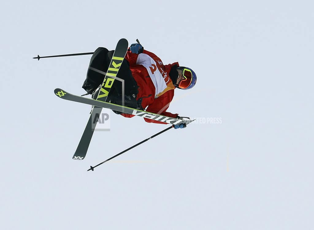 The Latest:  Fourcade wins biathlon gold in a photo finish