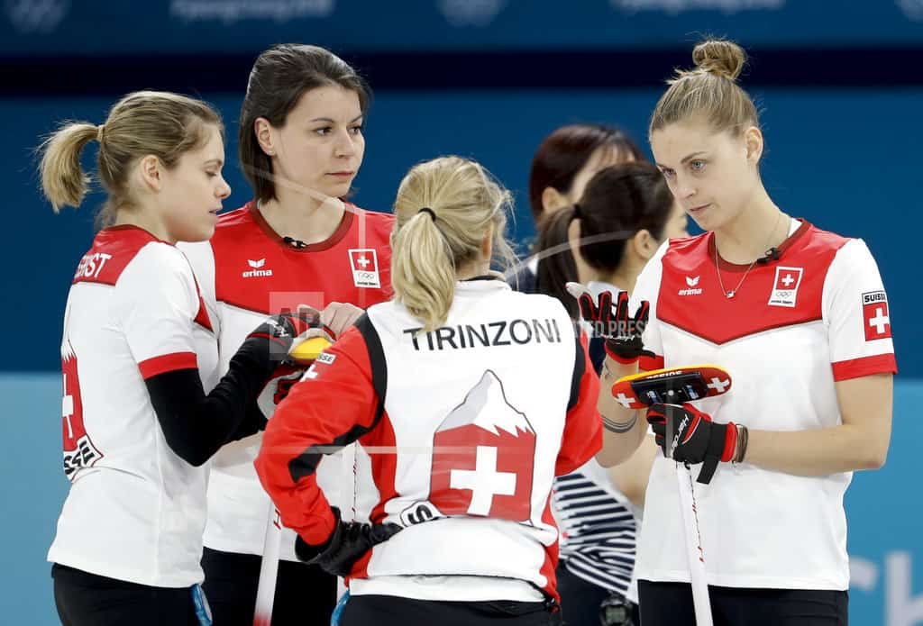 The Latest: Curler: Russian facing charge should lose medal