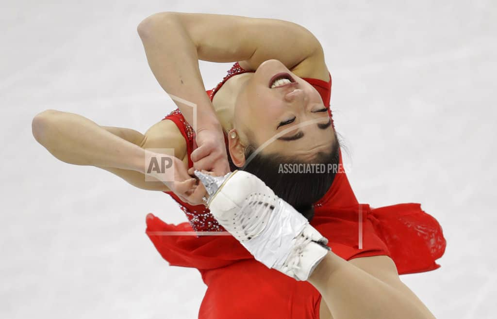 The Latest: American skater Tennell makes rare mistake