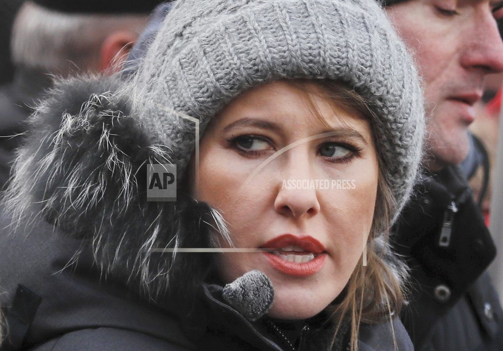 Russian presidential candidate Sobchak is doused with water