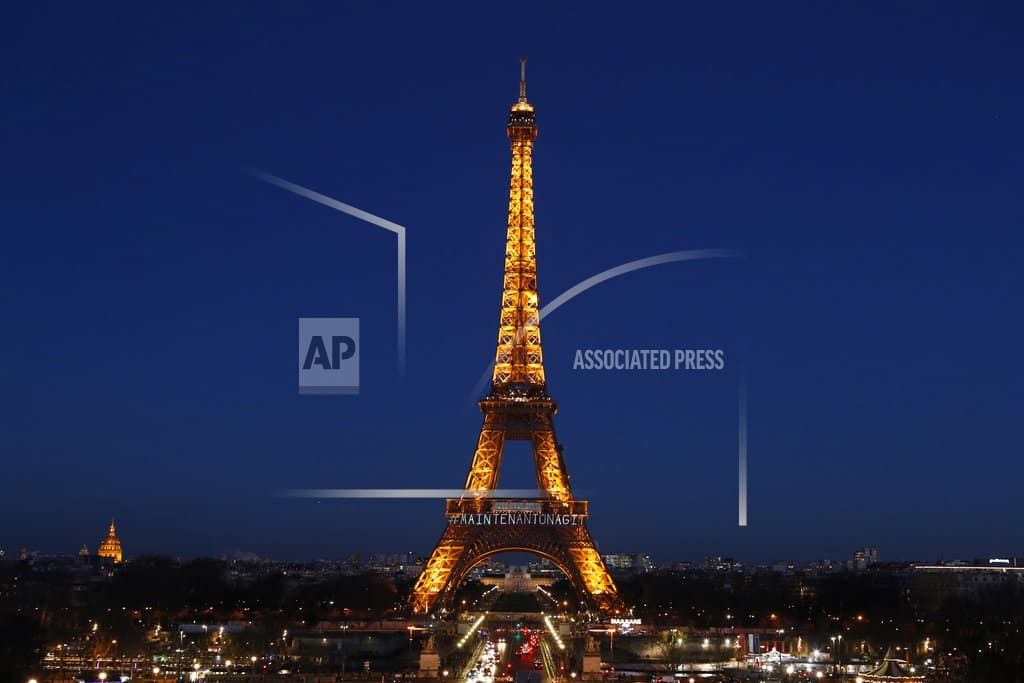 The Latest: Women's day: France to get tough on wage gap