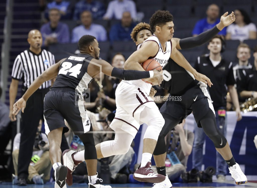 The Latest: Texas A&M big men bounce Providence out of NCAA