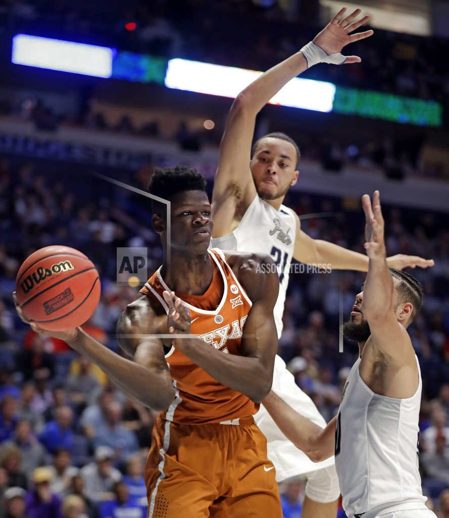 Seventh-seeded Nevada rallies, tops Texas 87-83 in overtime