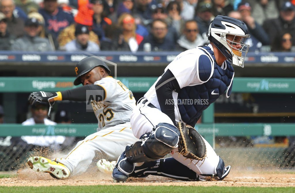 Replay review saves Pirates, beat Tigers 13-10 in 13th