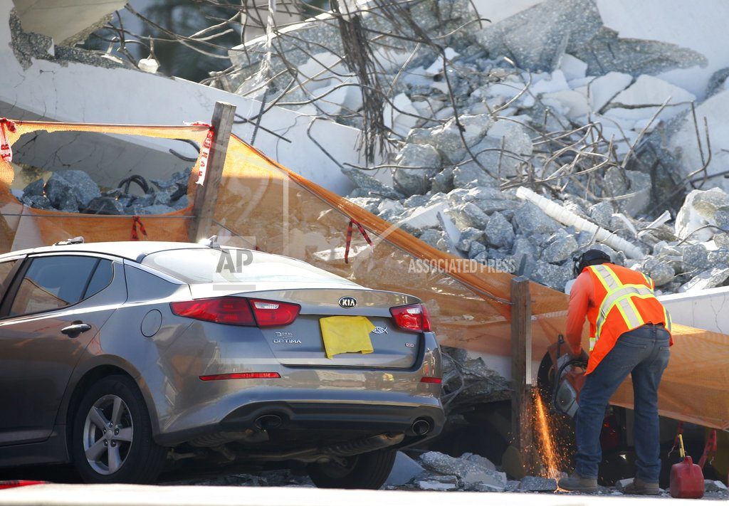 The Latest: Caller reported cracks in bridge before collapse