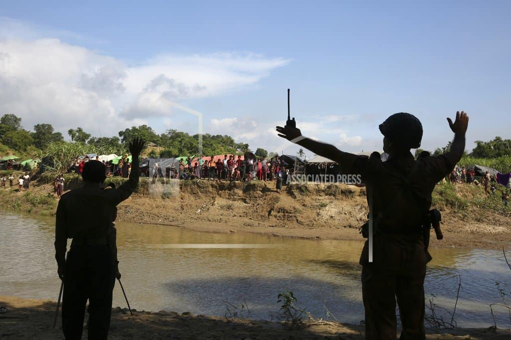 At the border's cloudy edge, Rohingya insist they will stay