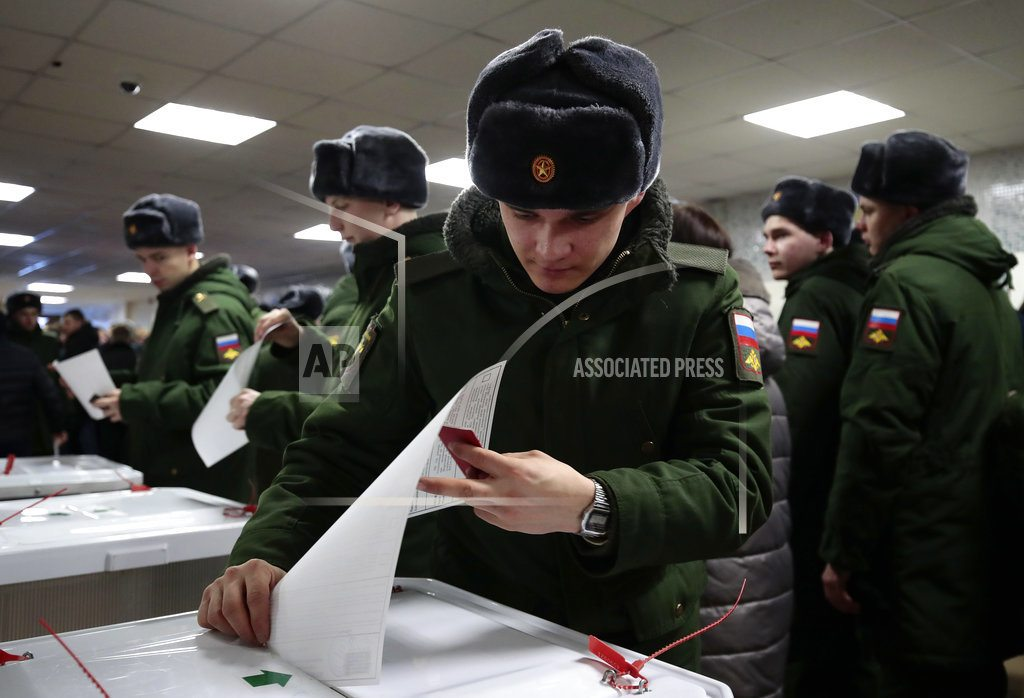 The Latest: Russia election website reports hacking attempt