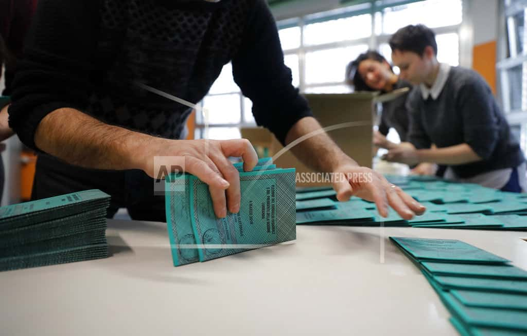 The Latest: First glitches appear in Italian voting