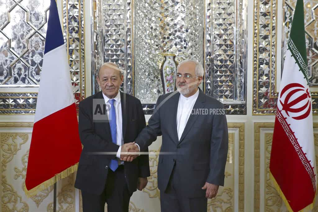 French foreign minister in Iran amid missile criticism