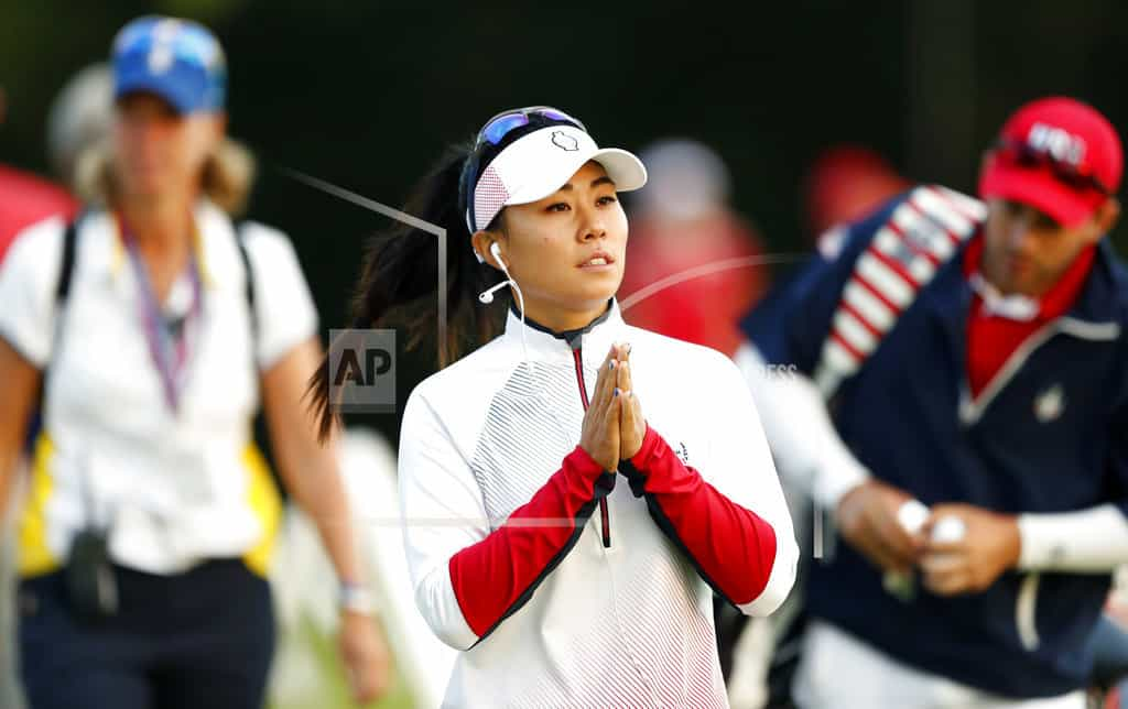 Broken tooth fails to stop Danielle Kang in Singapore