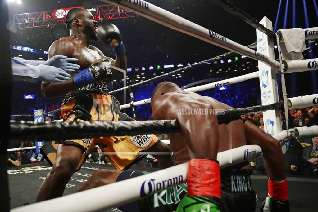 Wilder survives pummeling to stop Ortiz in 10th