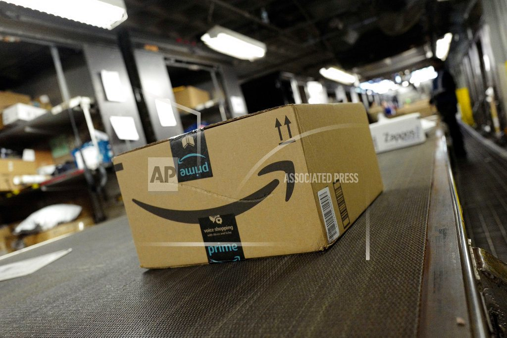 NEW YORK   Amazon's quarterly profit more than doubles; shares soar