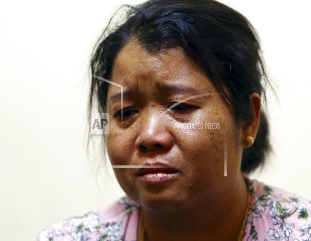 NAYPYITAW, Myanmar | Myanmar evicts kin of officer who told of reporters' setup