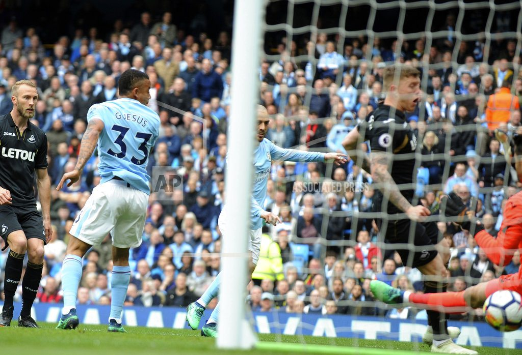 MANCHESTER, England | Chasing records, EPL champion Man City thrashes Swansea 5-0