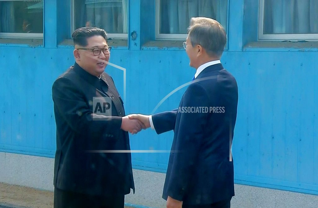 GOYANG, South Korea    Korean summit starts with a handshake, after year of tension
