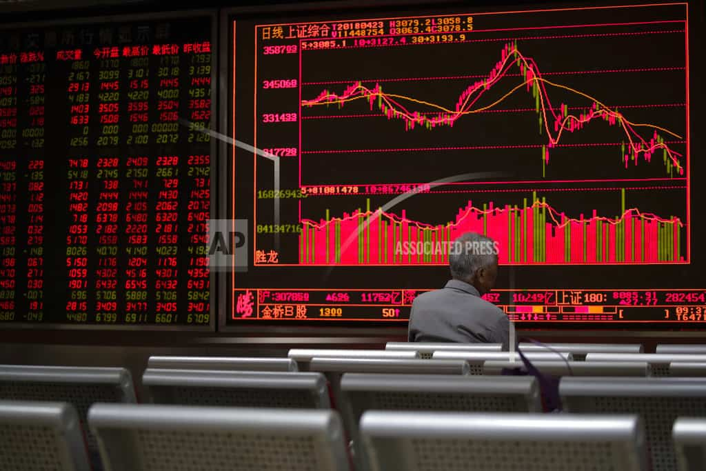 Asian shares mostly lower, tracking tech sell-off on Wall St