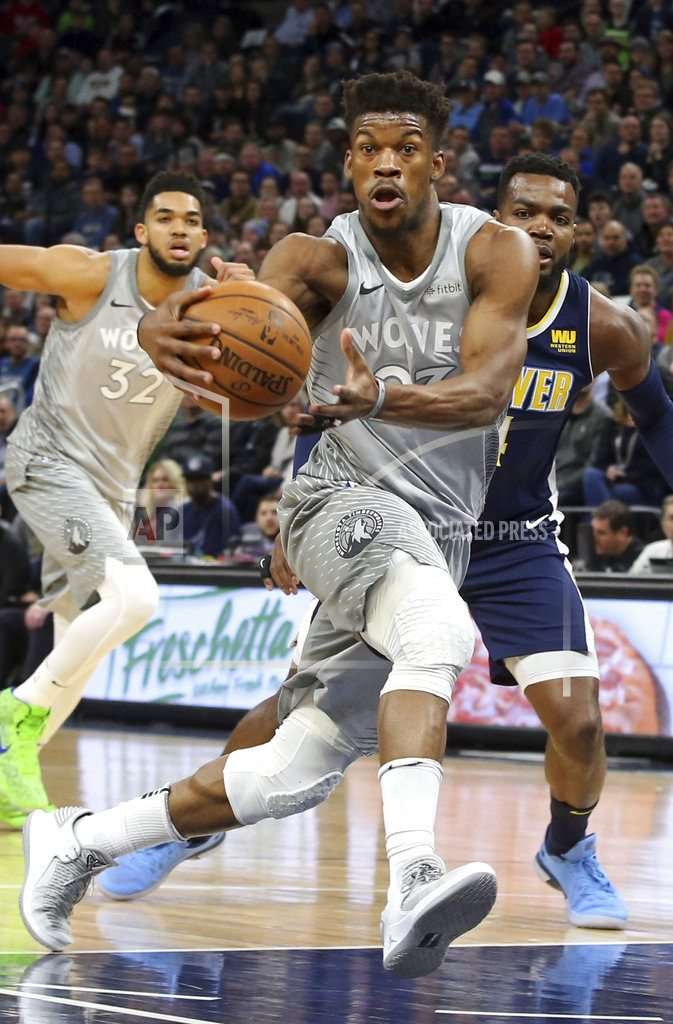 MINNEAPOLIS |  Butler, Towns lead T-wolves past Nuggets in OT, to playoffs