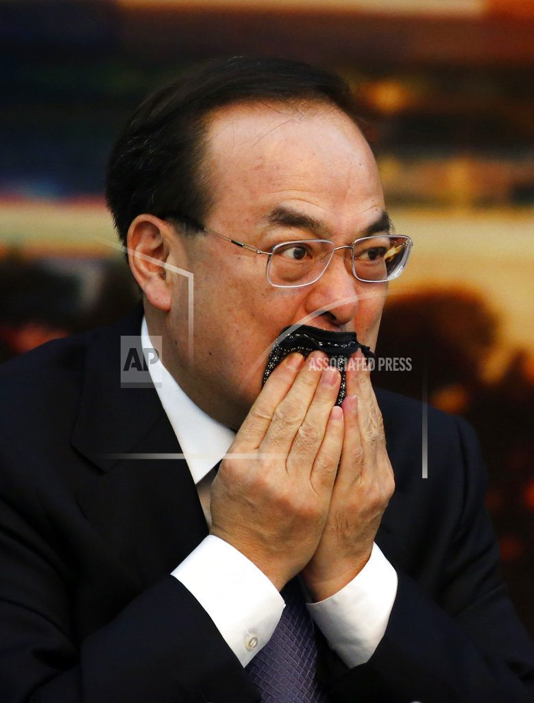 BEIJING | Chinese politician accused of conspiracy admits to graft