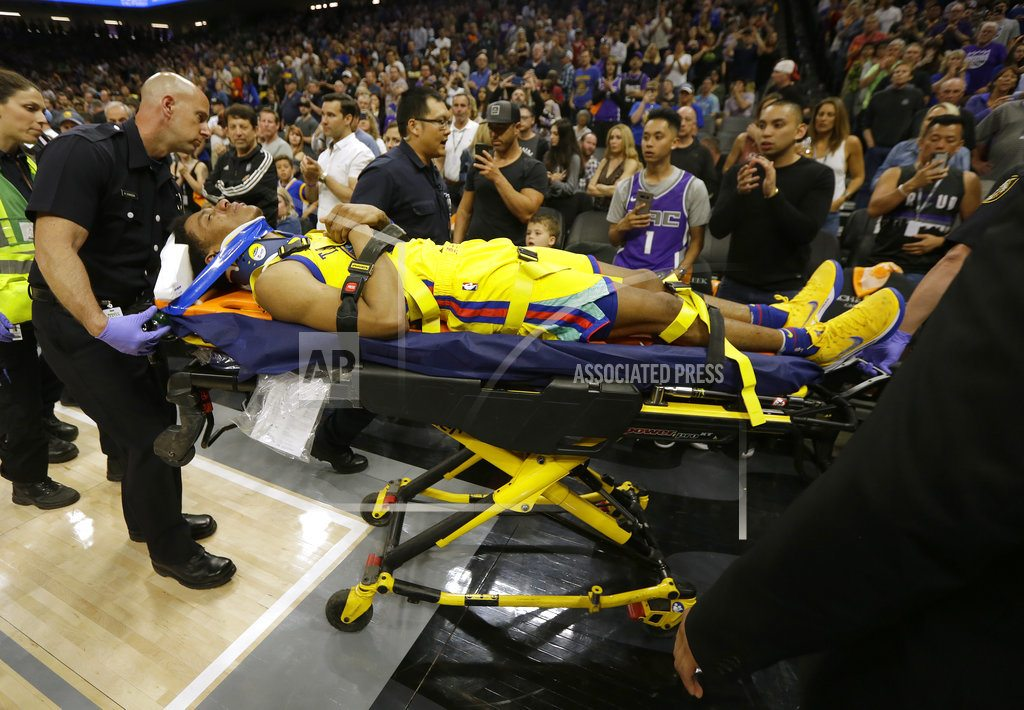 Warriors' McCaw leaves on stretcher after hard fall