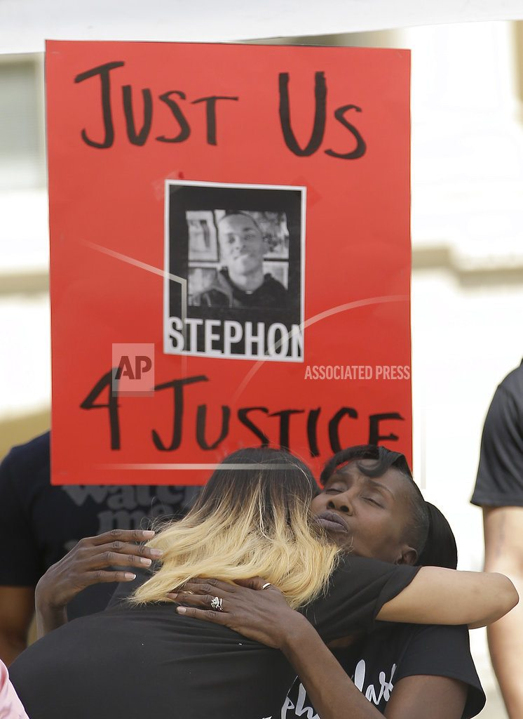Family of man killed by police joins rally for reform