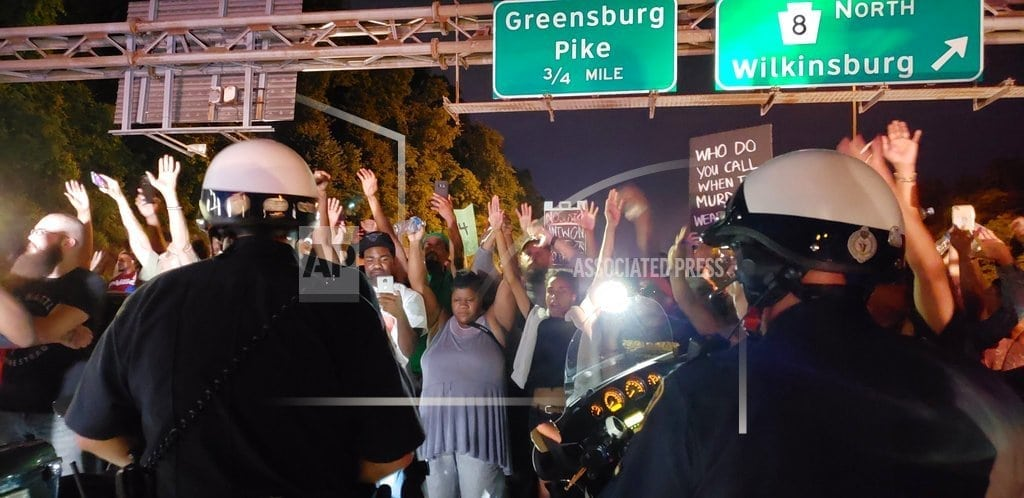 Police shooting of boy spurs more protests, appeals